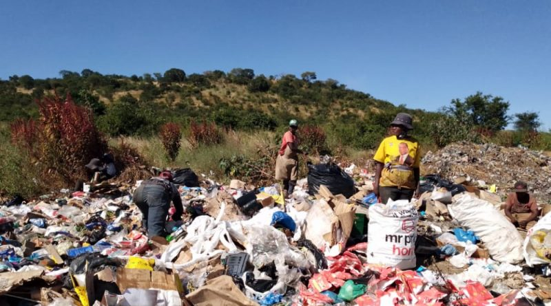 In Picture : women at the dump site going through waste searching for materials to recycle